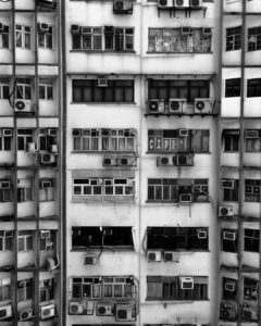 """the height of the ridiculous~will be sharing some images from inside the notorious Chungking Mansions. Working on a project there. Chungking Mansions is a building located at 36–44 Nathan Road in Tsim Sha Tsui, Kowloon, Hong Kong. The building is well known as nearly the cheapest accommodation in Hong Kong. Though the building was supposed to be residential, it is made up of many independent low-budget hotels, shops and other services. The unusual atmosphere of the building is sometimes compared to that of the former Kowloon Walled City.[1] Chungking Mansions features guesthouses, curry restaurants, African bistros, clothing shops, sari stores, and foreign exchange offices. It often acts as a large gathering place for some of the ethnic minorities in Hong Kong, particularly South Asians (Indians, Nepalese, Pakistanis, Bangladeshis and Sri Lankans), Middle Eastern people, Nigerians, Europeans, Americans, and many other peoples of the world. Peter Shadbolt of CNN stated that the complex was the """"unofficial African quarter of Hong Kong"""".[2] The building was completed in 1961, at which time Chinese residents predominated. Now, after more than five decades of use, there are an estimated 4,000 people living in the complex"""